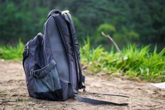 A Rucksack On A Ground With Nature Background royalty free stock photo
