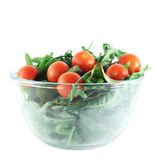 Rucola ,Chard and cherry tomatoes salad. In transparent bowl isolated on white Stock Image