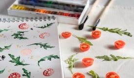 Rucola di American National Standard dei pomodori ciliegia Fotografia Stock