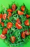 Rucola e pomodori ciliegia Fotografia Stock