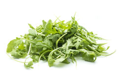 Rucola. Heap of rucola leaves isolated on white background royalty free stock photo