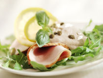 Rucola salad with ham and sauce Royalty Free Stock Photo