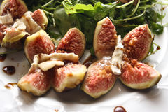 Rucola salad with walnuts and fresh figs Royalty Free Stock Photo