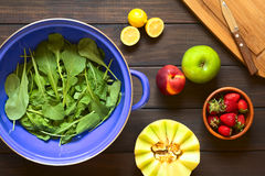 Rucola in Strainer with Fruits Royalty Free Stock Image
