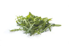 Rucola on white. Stack of Salad rocket rucola isolated on white royalty free stock images