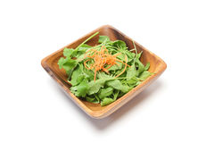 Rucola in a wooden bowl Stock Photo