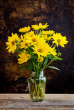 Rudbeckia bright yellow flowers bouquet on dark background Royalty Free Stock Photography