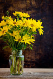 Rudbeckia bright yellow flowers bouquet on dark background Stock Image