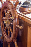 Rudder. With compass in background on a yacht Stock Image