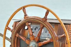 Rudder. Detail of rudder and navigation instruments on a wooden sailboat Royalty Free Stock Photo