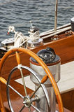 Rudder and compass. On a wooden boat Royalty Free Stock Image