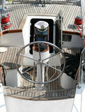 Rudder, compass and captain's hat. On wooden yacht Royalty Free Stock Photo