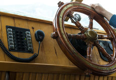 Rudder on a yacht. Captain controlling rudder on a yacht Royalty Free Stock Photo