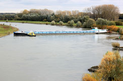 Rudderless freighter in the dutch river of IJssel. On October 25, 2012, a german freighter is become adrift after a power failure, at the river of IJssel in the Stock Photos