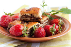 Ruddy biscuits and fresh strawberries Royalty Free Stock Photo