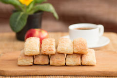 Ruddy cakes with apple and coffe. Sweet beautiful cakes and a cup of coffee on the table Stock Photography