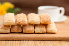 Ruddy cakes and coffee. Sweet beautiful cakes and a cup of coffee on the table Stock Photo
