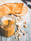 Ruddy crispy toast with peanut butter for breakfast, bread Royalty Free Stock Image