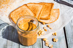 Ruddy crispy toast with peanut butter for breakfast, bread Royalty Free Stock Images