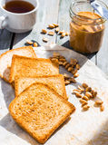 Ruddy crispy toast with peanut butter for breakfast, closeup Stock Photo