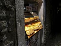 Ruddy fresh pizza in a small bakery in Old Budva royalty free stock photos