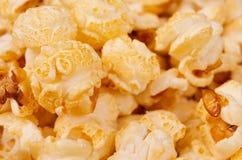 Ruddy golden popcorn closeup with blur background. Ruddy golden popcorn closeup with blur background Stock Image