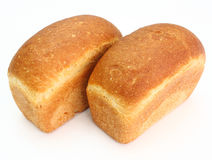 The ruddy long loaf of bread. With the fried crust is isolated on a white background Royalty Free Stock Images