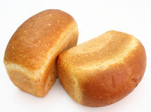 The ruddy long loaf of bread. With the fried crust is isolated on a white background Stock Photography