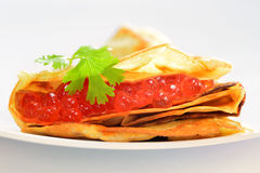 Ruddy pancake stuffed with red caviar, shrove Stock Photography