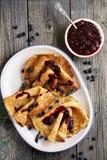 Ruddy pancakes with fresh honeysuckle Stock Photo