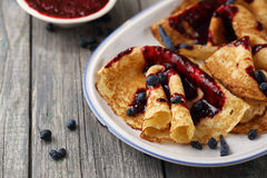 Ruddy pancakes with honeysuckle Royalty Free Stock Images
