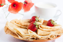 Ruddy pancakes, strawberries and milk Royalty Free Stock Photos