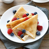 Ruddy summer pancakes with raspberries Royalty Free Stock Photography