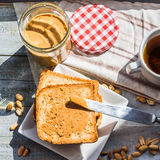 Ruddy toast and peanut butter, a delicious breakfast Stock Images