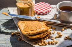 Ruddy toast and peanut butter, a delicious breakfast Stock Photo