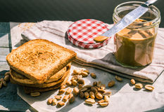 Ruddy toast and peanut butter, a delicious breakfast Royalty Free Stock Images