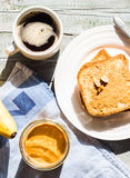 Ruddy toast with peanut butter, fresh bananas, coffee, breakfast Stock Photos