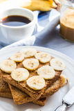 Ruddy toast with peanut butter, sliced ​​bananas, coffee, br Royalty Free Stock Photos