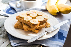 Ruddy toast with peanut butter, sliced ​​bananas, coffee, br Royalty Free Stock Photography