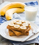 Ruddy toast with peanut butter, sliced ​​bananas, milk, brea Stock Image