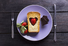 Ruddy toast by Valentine's Day. On plates with strawberry Royalty Free Stock Photos