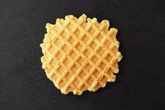 Ruddy wafer on a plate of slate Stock Photography