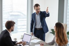 Rude angry boss demanding to leave meeting irritated by businesswoman royalty free stock photos