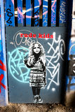 Rude child graffiti wall art, London UK Royalty Free Stock Images