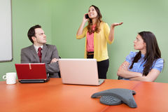 Rude colleague disturbing meeting Stock Photo