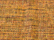 Rude cotton fabric, mixed with yellow, black and orange. Rude cotton fabric in close-up, with ripple, mixed with yellow, black and orange Stock Photo