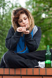 Rude girl smoking Stock Photo