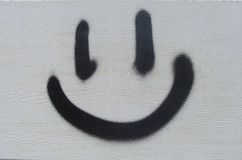 Rude graffiti smile in black and white Royalty Free Stock Photo