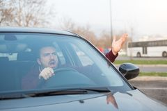 Rude man driving his car and arguing. A lot Royalty Free Stock Images