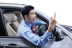 Rude person showing middle finger in the car Stock Image